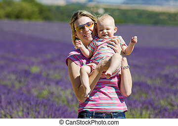 mother with her baby girl, Plateau de Valensole, Provence,...