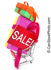 gifts and a signboard with the word sale in a shopping cart...