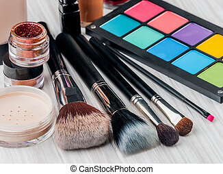Set of professional makeup and cosmetics on a light...