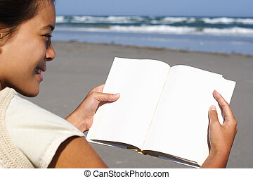 woman reading blank book