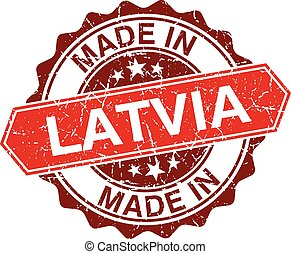 made in Latvia red stamp isolated on white background