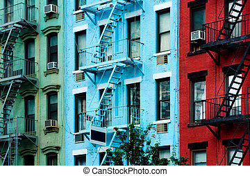 Colorful apartment buildings with fire escapes - Three...