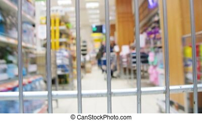 shopping cart in shop, grating - Shopping cart in shop,...