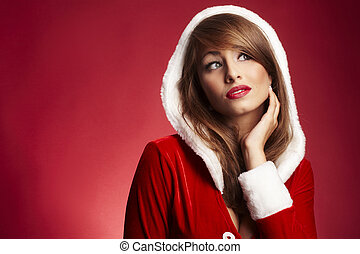 beautiful woman wearing fur hood on red background