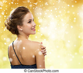 smiling woman in evening dress - people, holidays, christmas...