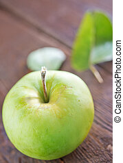 fresh apple - fresh and green apple on the wooden table