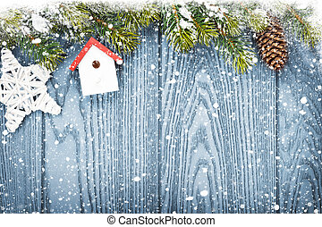 Christmas wooden background with snow fir tree and decor -...
