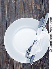 dishware - white plate, fork and knife on plate