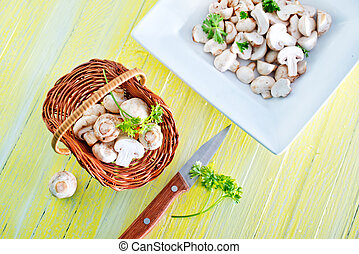 mushrooms - raw mushrooms in basket and on a table