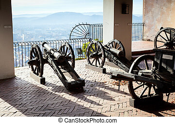 Old cannon on gun carriage aims to Graz