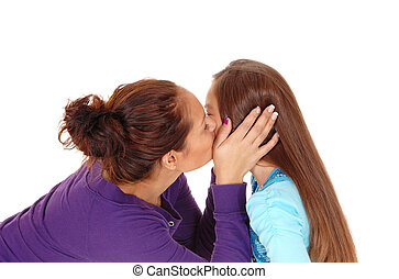 Mother kissing daughter. - A closeup picture of a mother...