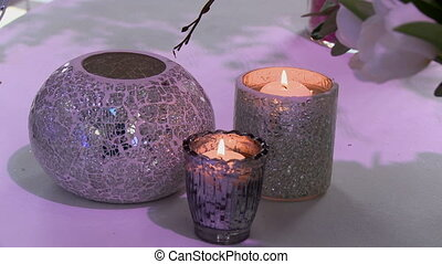 Decorated candle holders as interior elements