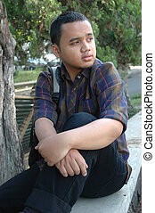 siting down - photograph of young adult siting down in park...