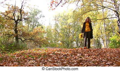 woman in autumn park walking