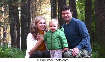 parents with boy in park
