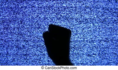 fist hand on tv screen