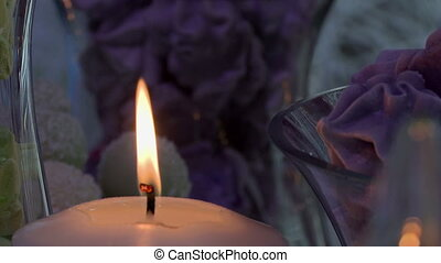 Close-up of candle's flame on desserts backdrop