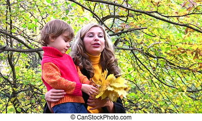 mother with children in autumn park - Mother with children...