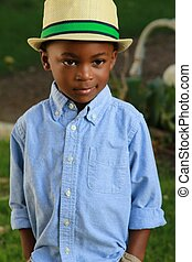 Young stylish black boy wear a hat - A 4 year old African...