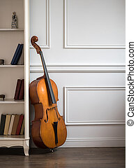 Cello in classical interior with bookshelf - Cello in...