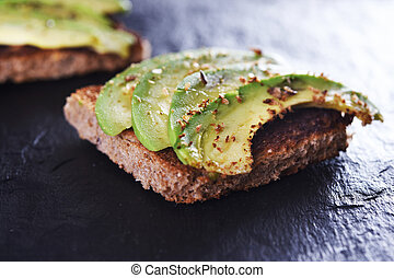 bread with avocado - sliced avocado on toast bread with...