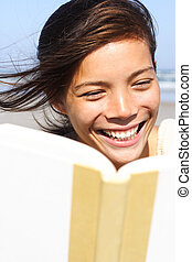 happy woman reading - woman student reading book in warm...
