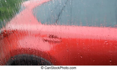 Rainy car window Red car - Waiting in car for rain to stop...