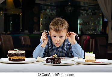 Little boy mesmerised by an assortment of cakes - Funny...