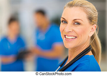 senior medical doctor portrait - portrait of confident...