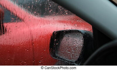 Rainy car window. - Waiting in car for rain to stop....