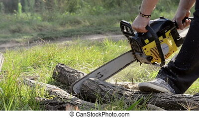 Gasoline powered professional chainsaw in the hands of a man