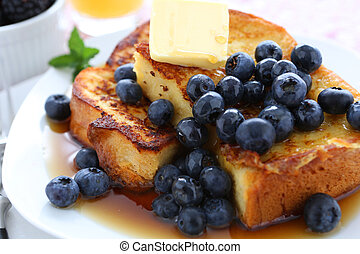 French Toast and Blueberries in breakfast setting.