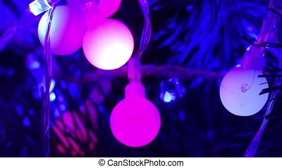 Christmas garland shimmering in different colors - twinkling...
