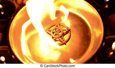 Ancient pentagram burning at altar