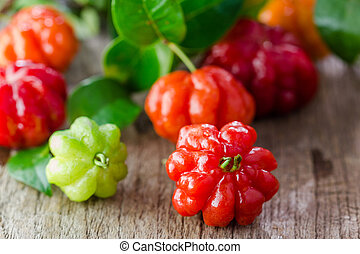 Tropical fruit also called Pitanga, Brazilian Cherry,...