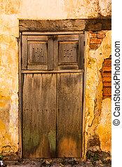 old brick wall with wooden door