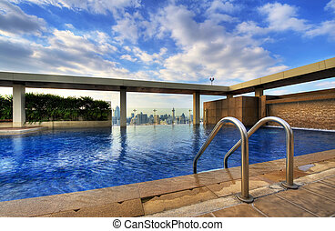 beautiful swimming pool on top of a highrise building in bangkok
