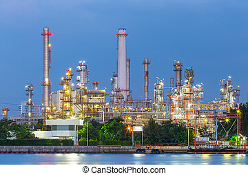 Oil refinery at twilight with sky background.