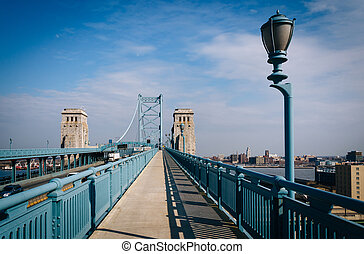 The Ben Franklin Bridge Walkway, in Philadelphia,...