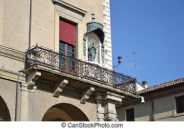Balcony of old medieval building on Piazza Cavour - Balcony...