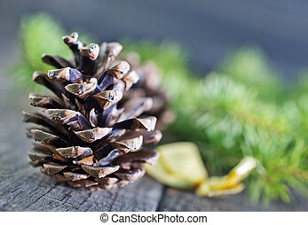 pinecones and christmas candle on a table