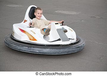 Boy on toy car