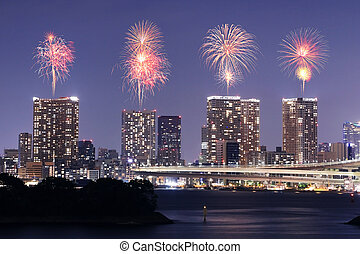 Fireworks celebrating over Tokyo cityscape at nigh -...
