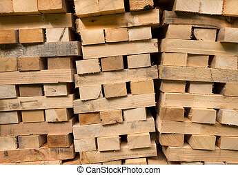 Piled wooden beams - Detail shot of three piles of piled...