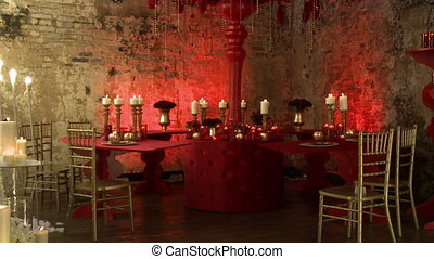 View of festively decorated loft-style restaurant in red...
