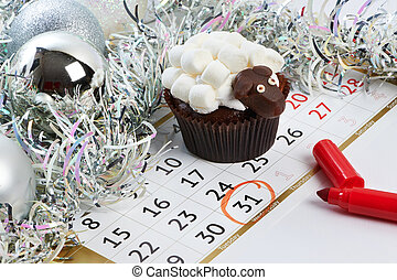 Cupcake lamb with calendar as simbol 2015 new years isolated...