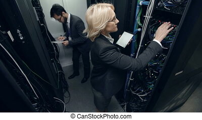 Innovative Systems - Two colleagues in supercomputer cabinet...