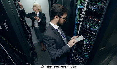 Supercomputer Unit - Man and woman from research department...