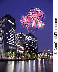 Fireworks celebrating over Tokyo cityscape at night of Japan