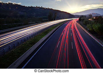 Light beams of vehicles on highway. - Colorful Light beams...